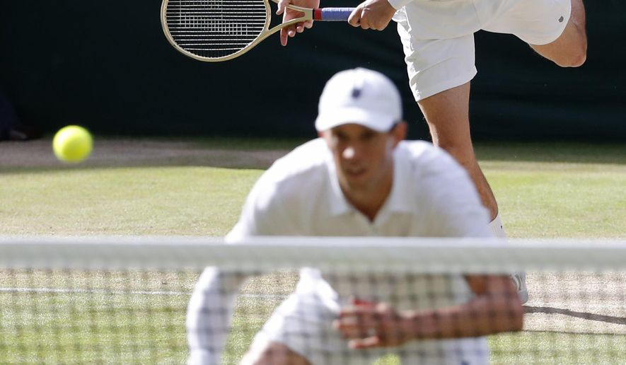 """File-This July 5, 2016, file photo shows Mike Bryan, front, and Bob Bryan of the U.S return to Nenad Zimonjic of Serbia and Radek Stepanek of the Czech Republic during their men's doubles match on day eight of the Wimbledon Tennis Championships in London. Bob and Mike Bryan will not defend their Olympic doubles title in Rio, citing health concerns. The twins announced their withdrawal on their Facebook page Saturday, July 30, 2016, saying that as """"husbands and fathers, our family's health is now our top priority."""" They didn't mention the Zika virus, which has been linked to birth defects. (AP Photo/Ben Curtis, File)"""