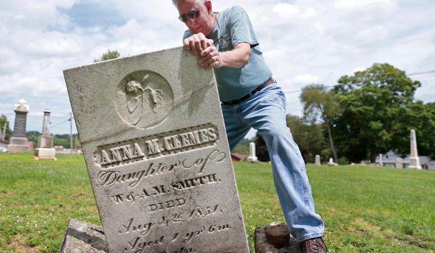 ADVANCE FOR MONDAY AUG. 1 - In this Tuesday, July 19, 2016 photo, Dave Larson straightens the gravestone for an 18-month-old girl at Old City Cemetery in Mineral Point, Wis. Larson is spearheading an effort to restore the cemetery and its gravestones. Numerous children are buried in the cemetery, victims of cholera epidemics and a time when infant mortality was far higher than it is today. (AP Photo/Wisconsin State Journal,  M.P. King)