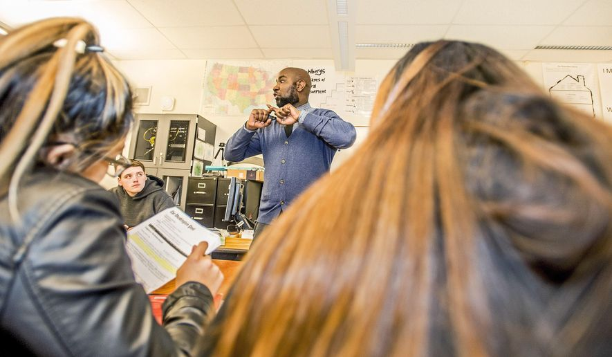 In this Thursday, Dec. 17, 2015 photo, Nathan Gibbs-Bowling, a teacher at Lincoln High School, who was named Washington State Teacher of the Year, speaks to students at the school in Tacoma, Wash. (David Montesino/The News Tribune via AP)