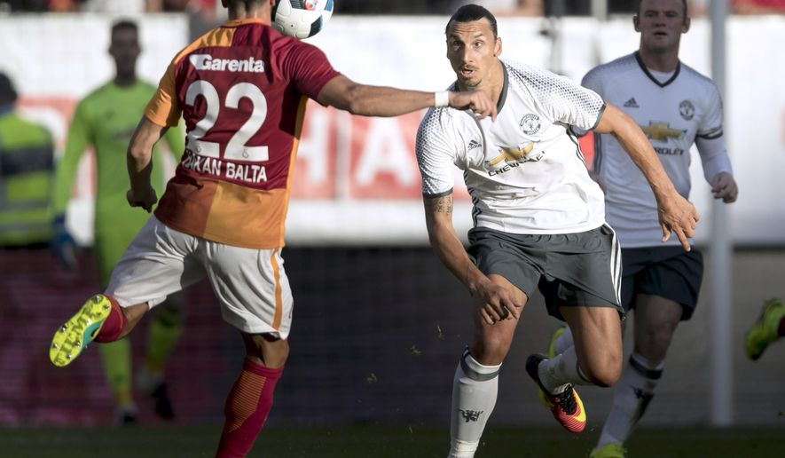 Galatasaray's Hakan Balta, left, controls the ball in front of Manchester United's Zlatan Ibrahimovic during their pre-season friendly soccer match at the Ullevi Stadium, in Gothenburg, Sweden, Sunday, July 30, 2016. (Bjorn Larsson Rosvall/TT News Agency via AP)
