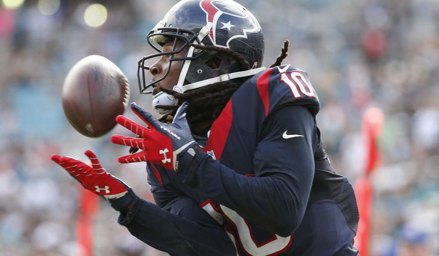 FILE - In this Oct. 18, 2015, file photo, Houston Texans wide receiver DeAndre Hopkins makes a catch for a touchdown against the Jacksonville Jaguars during an NFL football game in Jacksonville, Fla. Hopkins did not report to training camp Saturday, July 30, 2016. Entering his fourth pro season, Hopkins is holding out for a new contract. He is scheduled to make $1 million in salary in the final season of his rookie contract, though the Texans have picked up his fifth-year option. (AP Photo/Stephen B. Morton, File)