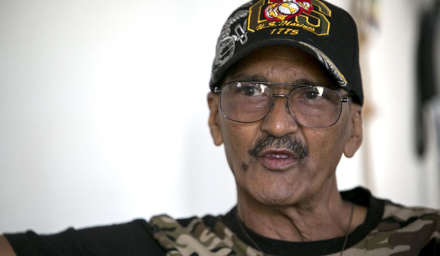 In this April 11, 2016 photo Eugene Morris speaks in his home in Ogden, Utah. In the decades after the war Morris struggled with drug addiction and homelessness until going through rehab six years ago and finding assistance with the Ogden Homeless Veterans Fellowship. (Benjamin Zack/Standard-Examiner via AP) TV OUT; MANDATORY CREDIT