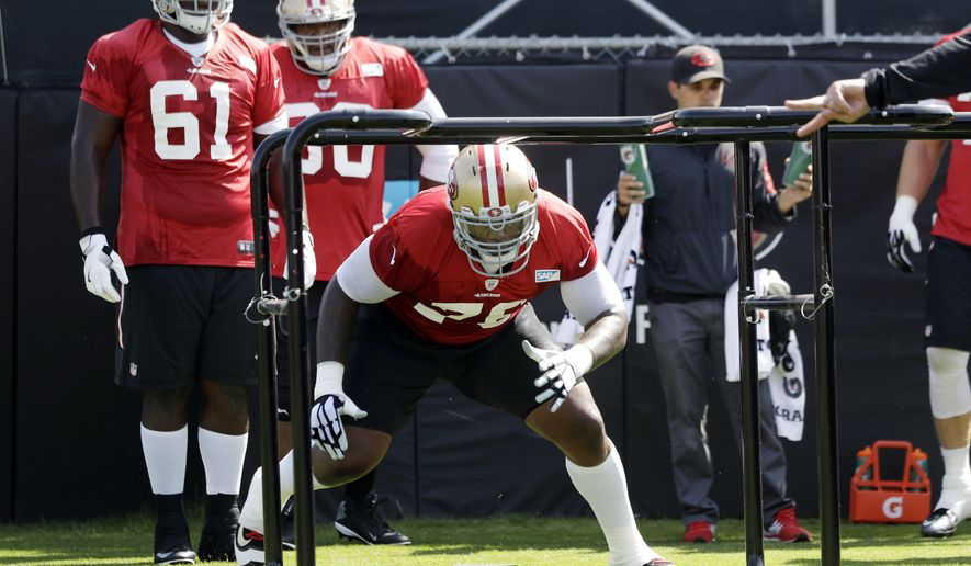 San Francisco 49ers' Anthony Davis, front, goes through drills during NFL football training camp Sunday, July 31, 2016, in Santa Clara, Calif. (AP Photo/Marcio Jose Sanchez)