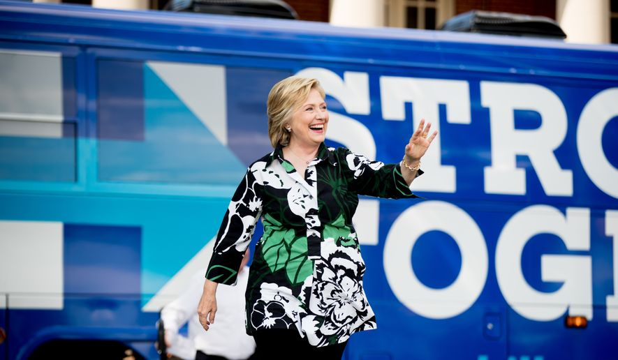 Democratic presidential candidate Hillary Clinton arrives at a rally at the Fort Hayes Metropolitan Education Center in Columbus, Ohio, Sunday, July 31, 2016. Clinton and running mate Tim Kaine are on a three-day bus tour through the rust belt. (AP Photo/Andrew Harnik)