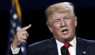 In this photo taken July 1, 2016, Republican presidential candidate Donald Trump speaks in Denver.  As he turns his attention to the general election, Donald Trump is signaling that he is ready to tone down his fiery rhetoric on illegal immigration _ at least behind closed doors.  (AP Photo/David Zalubowski)