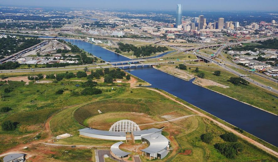 FILE - In this undated file photo provided by The American Indian Cultural Center and Museum, the uncompleted center, bottom, is pictured with the city of Oklahoma City at rear. Construction began in 2006 but has been dormant since 2012 when the project ran out of money and the Republican-controlled Legislature refused to allocate new funds. (Kimberly Rodrigue/The American Indian Cultural Center and Museum, via AP, File)
