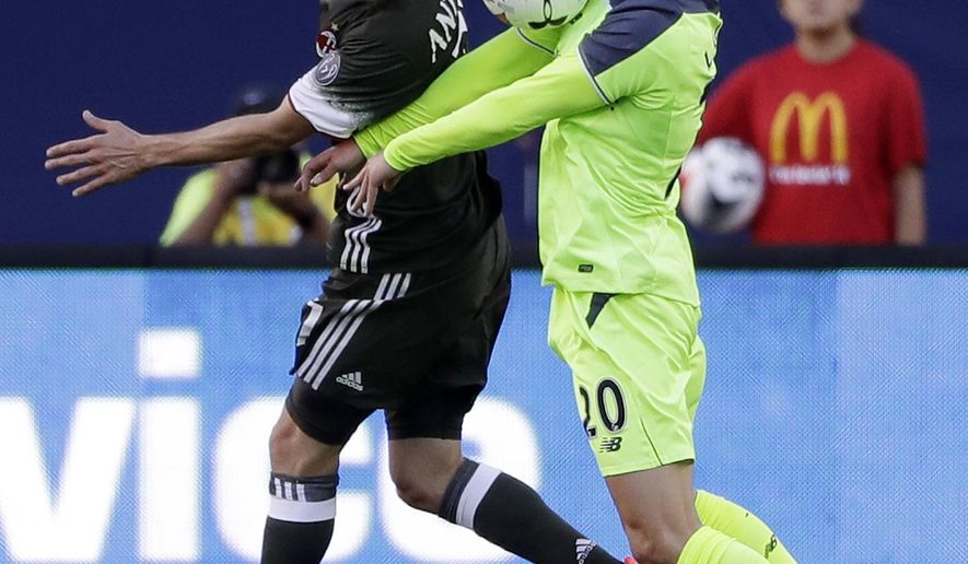 Liverpool midfielder Adam Lallana, right, works for control against AC Milan defender Luca Antonelli during the first half of an International Champions Cup soccer match Saturday, July 30, 2016, in Santa Clara, Calif. (AP Photo/Marcio Jose Sanchez)