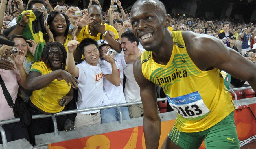 FILE - In this Aug. 16, 2008, file photo, Usain Bolt of Jamaica smiles at cheering spectators after winning the men's 100-meter final with a world record in the National Stadium at the Beijing 2008 Olympics in Beijing. Since he coasted to the 100-meter finish line in world-record time at the Bird's Nest eight years ago, Usain Bolt has been the smiling face of track and field. He has served as the anchorman of the Olympics, virtually the only reason any casual fan would pay attention to a sport that has orchestrated its own slow, sad, drug-infused downfall. (AP Photo/Thomas Kienzle, File)
