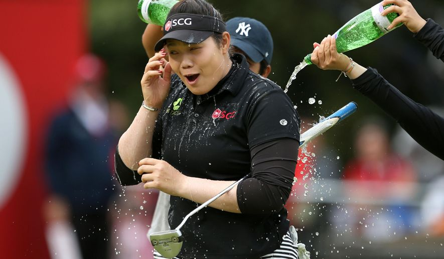 Thailand's Ariya Jutanugarn celebrates after sinking her putt to win the Women's British Open during day four of the Women's British Open at Woburn Golf Club, Woburn, England, Sunday July 31, 2016. Jutanugarn took the Women's British Open title at the tree-lined Woburn course. (Steve Paston / PA via AP)