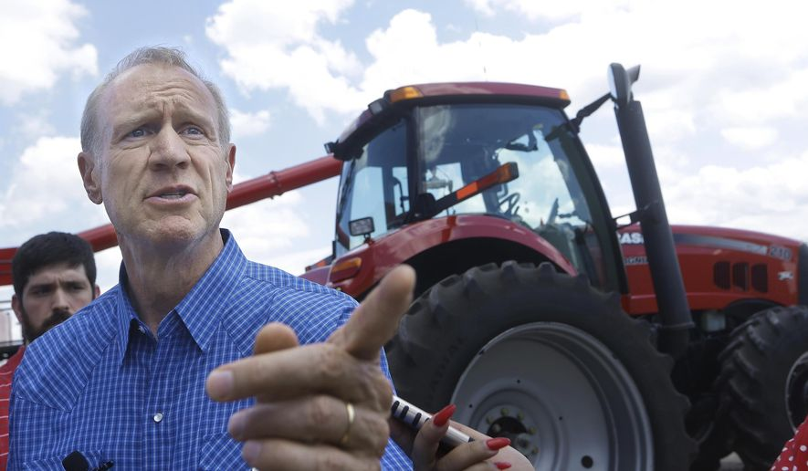FILE - In this Tuesday, July 26, 2016 file photo, Illinois Gov. Bruce Rauner speaks to farmers and local area residents about the need for term limits and redistricting reform while visiting the Garry Niemeyer corn and soybean farm in Auburn, Ill. Republican lawmakers proposed legislation on term limits and redistricting but their ideas went nowhere with ruling Democrats. Rauner's recent campaign-style events offer a preview of how the Illinois candidates he is financially backing will approach their races. (AP Photo/Seth Perlman, File)