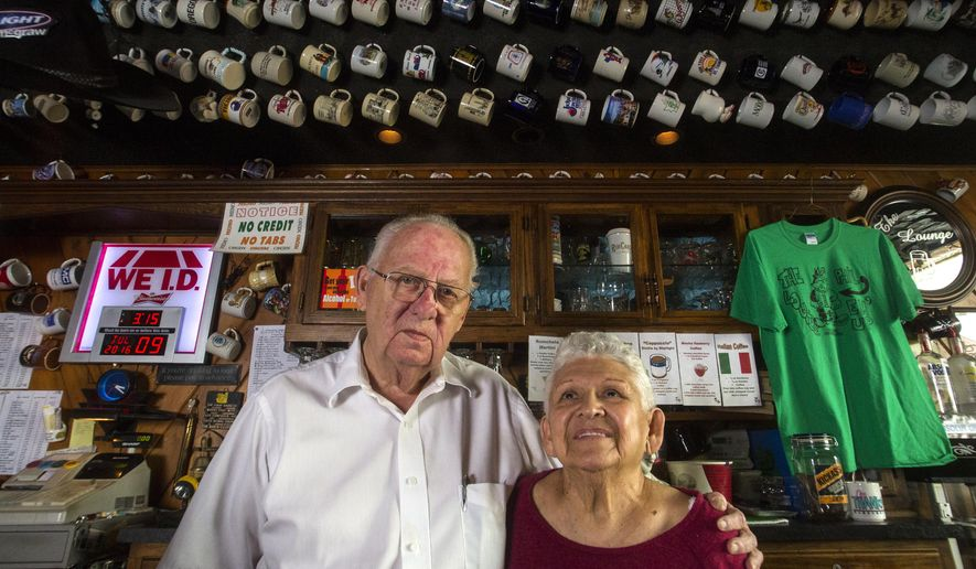 ADVANCE FOR SUNDAY JULY 31 - In this Saturday, July 9, 2016 photo, Bar owners Phil and Mary Love stand behind the bar at The Lounge in Dubuque, Iowa. The Lounge opened the space in 1980 and are known as legends in the town. It hasn't changed much. (Adam Warner/Telegraph Herald via AP)