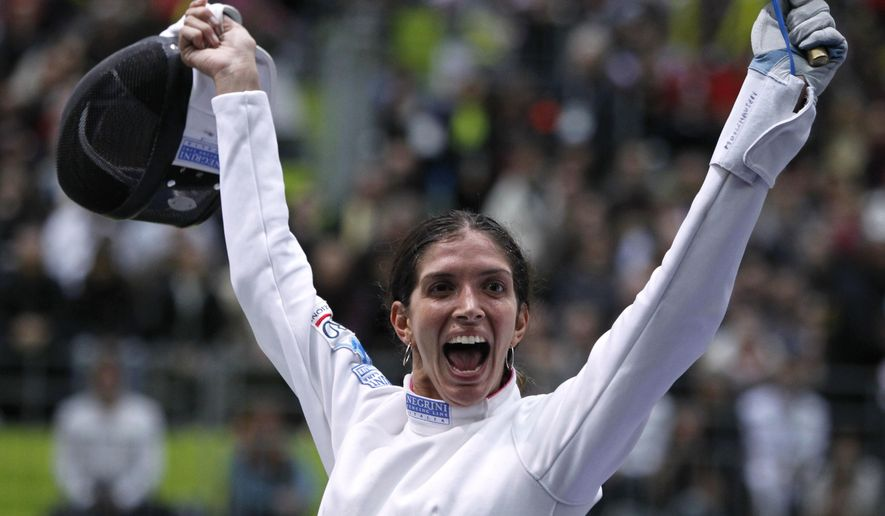 FILE - In this Nov. 8, 2010, file photo, Italy's Nathalie Moellhausen reacts as she defeats Poland's Magdalen Piekarska in a women's single epee quarterfinal during the fencing World Championships in Paris. To fulfill an old dream of her 82-year-old grandmother, Marcela Farotti, Moellhausen will be competing for the hosts at the 2016 Rio de Janeiro Games. (AP Photo/Francois Mori, File