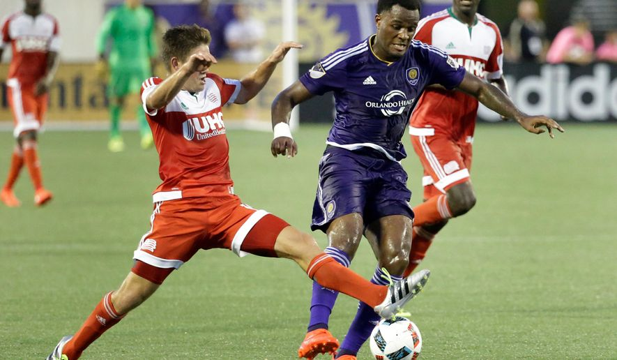 Orlando City 's Cyle Larin, center, moves the ball between New England Revolution's Kelyn Rowe, left, and JeVaughn Watson during the first half of an MLS soccer game, Sunday, July 31, 2016, in Orlando, Fla. (AP Photo/John Raoux)