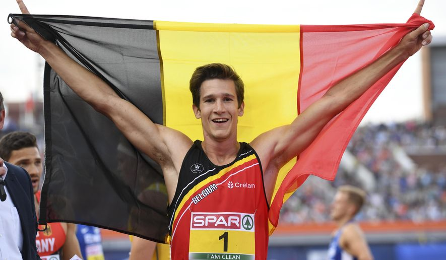 In this Thursday, July 7, 2016 photo, Belgium's Thomas Van Der Plaetsen celebrates after winning the gold medal in the men's Decathlon, at the European Athletics Championships in Amsterdam, the Netherlands.   At his lowest point chemotherapy had turned him bald and weak at aged 23, but barely 18-months later, Thomas Van der Plaetsen is heading to the Rio 2016 Olympics as the European decathlon champion and with a full head of brown hair. (AP Photo/Geert Vanden Wijngaert)