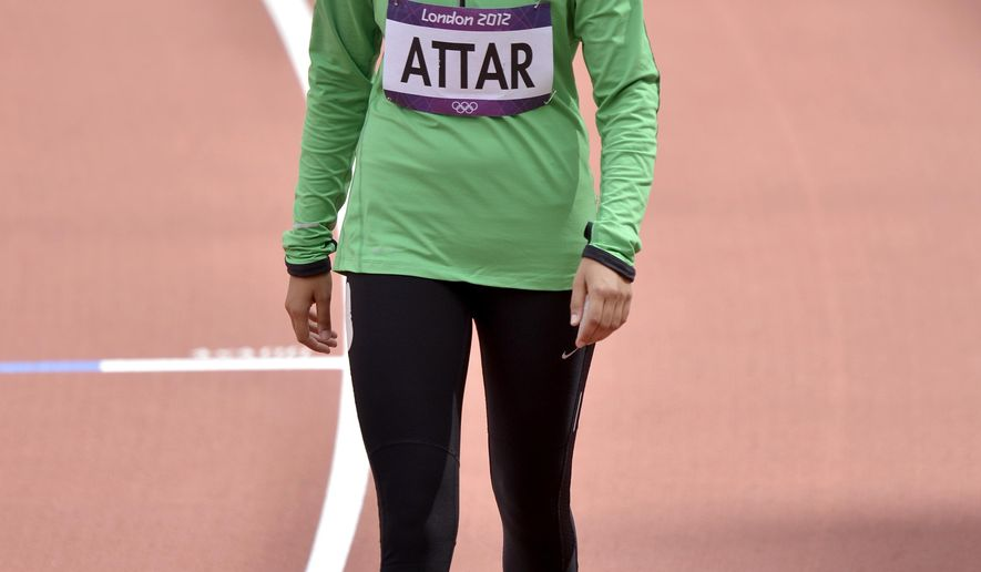FILE -- In this Aug. 8, 2012 file photo, Saudi Arabia's Sarah Attar prepares to compete in a women's 800-meter heat during the athletics in the Olympic Stadium at the 2012 Summer Olympics, London. Saudi Arabia will send four women to the Rio de Janeiro Olympics, doubling its female participation after two females took part in the 2012 London Games for the first time. Two of the athletes will participate in track and field, one in judo and one in fencing, Hosam al-Qurashi, executive director of the Saudi Olympic Committee, told The Associated Press Sunday, July 31, 2016. Among the four is Sarah Attar, who was the first woman from Saudi Arabia to compete in Olympic track and field in 2012. (AP Photo/Martin Meissner, File)