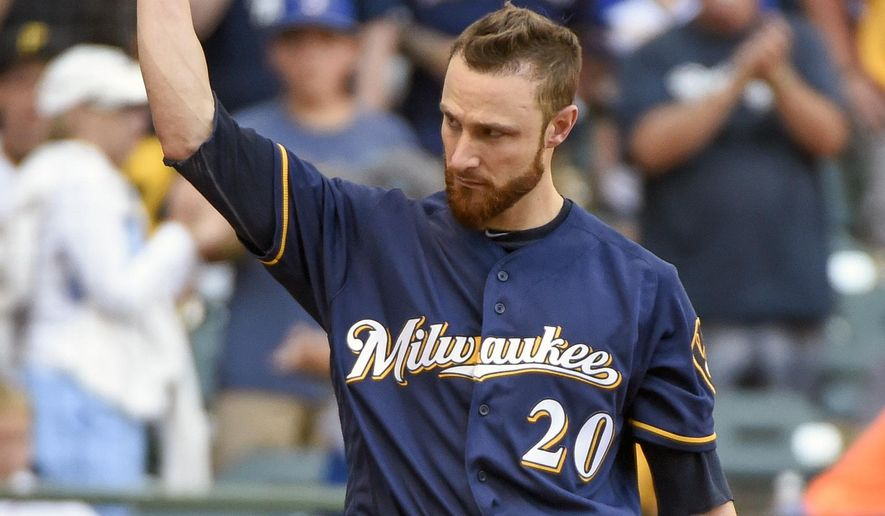 Milwaukee Brewers' Jonathan Lucroy tips his batting helmet after getting a standing ovation from fans while pinch-hitting during the eighth inning of a baseball game Sunday, July 31, 2016, in Milwaukee. Lucroy has blocked his proposed trade to the Cleveland Indians. Lucroy said Sunday, July 31, 2016, he was not going to go into the details behind his decision, but the long term is more important than the short term for him and his family. (AP Photo/Benny Sieu)