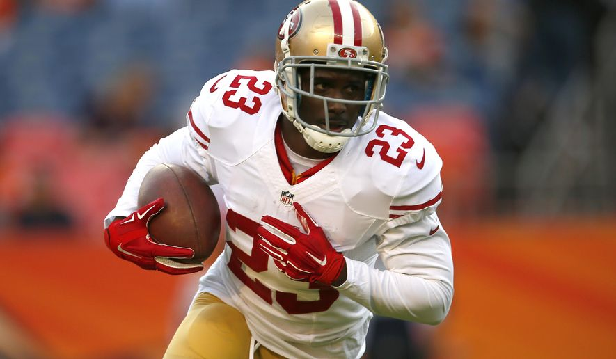 FILE - In this Aug. 29, 2015, file photo, San Francisco 49ers running back Reggie Bush (23) warms up prior to an NFL preseason football game against the Denver Broncos, in Denver. The Buffalo Bills brought in free-agent running back Reggie Bush for a visit on Monday, Aug. 1, 2016, with the intention of adding veteran depth behind starter LeSean McCoy. (AP Photo/Joe Mahoney, Aug. 29, 2015, file photo)