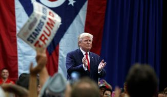 Republican presidential nominee Donald Trump avoided the controversy over a bereaved Muslim family during a town hall event Monday in Columbus, Ohio. (Associated Press)