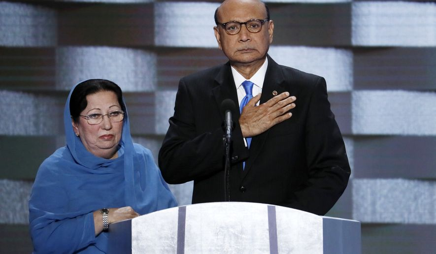Khizr Khan, father of fallen US Army Capt. Humayun S. M. Khan and his wife Ghazala speak during the final day of the Democratic National Convention in Philadelphia, July 28, 2016. Republican presidential nominee Donald Trump broke a major American political and societal taboo over the weekend when he engaged in an emotionally-charged feud with Khizr and Ghazala Khan, the bereaved parents of a decorated Muslim Army captain killed by a suicide bomber in Iraq. (AP Photo/J. Scott Applewhite, File) ** FILE **