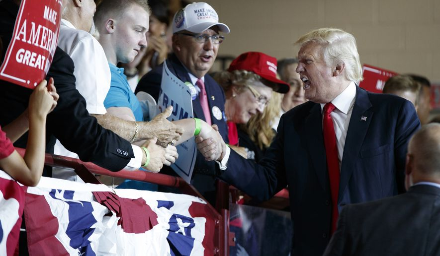 Republican presidential candidate Donald Trump shakes hands during a campaign rally at Cumberland Valley High School, Monday, Aug. 1, 2016, in Mechanicsburg, Pa. (AP Photo/Evan Vucci)