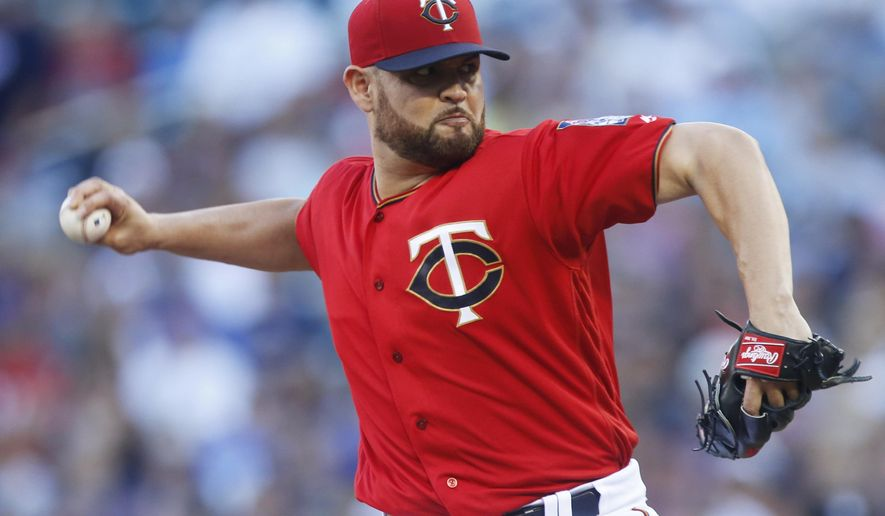 FILE - This July 29, 2016 file photo shows Minnesota Twins pitcher Ricky Nolasco throws against the Chicago White Sox during the first inning of a baseball game in Minneapolis. The Minnesota Twins have acquired starting pitcher Hector Santiago a minor-leaguer from the Los Angeles Angels for right-handers Ricky Nolasco and Alex Meyer and cash, Monday, Aug. 1, 2016. (AP Photo/Jim Mone, file)