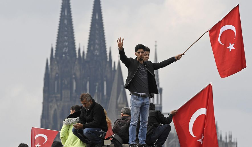 Turkish protesters demonstrate in Cologne, Germany, Sunday, July 31, 2016.  Thousands of supporters of Turkish President Recep Tayyip Erdogan have gathered in the German city of Cologne for a demonstration against the failed July 15 coup in Turkey.  .(AP Photo/Martin Meissner)