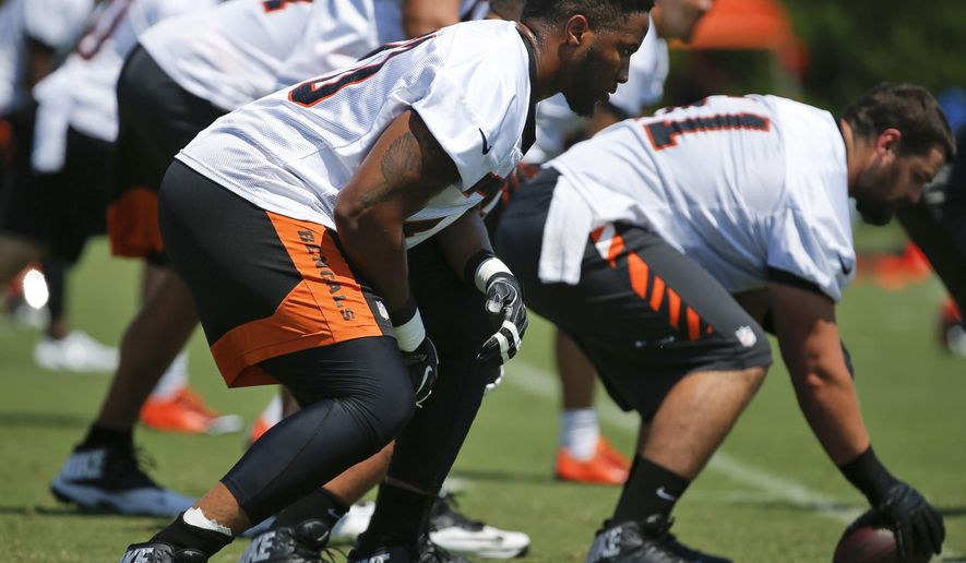 Cincinnati Bengals offensive tackle Cedric Ogbuehi (70) lines up for a play at the NFL football team's training camp, Saturday, July 30, 2016, in Cincinnati. (Kareem Elgazzar/The Cincinnati Enquirer via AP)