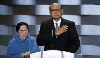 In this Thursday, July 28, 2016, file photo, Khizr Khan, father of fallen US Army Capt. Humayun S. M. Khan and his wife Ghazala speak during the final day of the Democratic National Convention in Philadelphia. (AP Photo/J. Scott Applewhite, File)