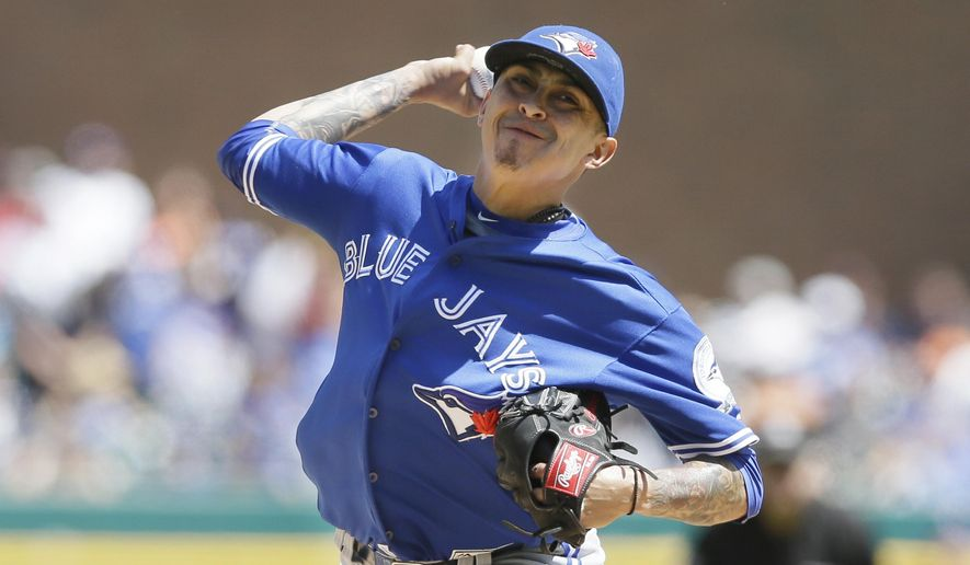 This June 8, 2016 file photo shows Toronto Blue Jays relief pitcher Jesse Chavez throws during the sixth inning of a baseball game against the Detroit Tigers in Detroit. The Toronto Blue Jays have acquired right-hander Mike Bolsinger from the Los Angeles Dodgers for right-hander Jesse Chavez and cash, Monday, Aug. 1, 2016.  (AP Photo/Carlos Osorio)