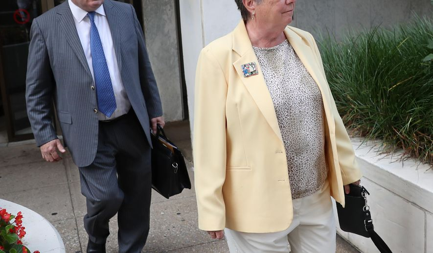 Former Pennsylvania Treasurer Barbara Hafer, right, and her attorney, John Knorr, walk out of the Federal Court Building in Harrisburg, Pa., Monday, Aug. 1, 2016. Hafer and businessman Richard Ireland were arraigned Monday in Harrisburg and released on their own recognizance with a trial date set for Oct. 4.  Hafer is charged with lying to federal agents, who were questioning her in their wide-ranging investigation to determine if government contacts were traded for contributions or bribes to politicians, commonly know as pay-to-play schemes.  (Michael Bryant/The Philadelphia Inquirer via AP) /The Philadelphia Inquirer via AP)  PHIX OUT; TV OUT; MAGS OUT; NEWARK OUT; MANDATORY CREDIT (for all of Their spot photos. Outs include 19 or so papers from N.J. and P.A.  --or-- MAGS OUT;  NEWARK OUT (for photos Taken a day or More earlier )