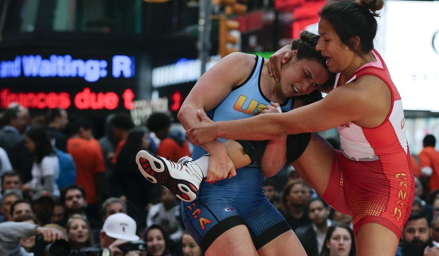 FILE - In this May 19, 2016, file photo, Adeline Gray, left, attempts to take down Canada's Justina Di Stasio during the Beat the Streets wrestling exhibition in Times Square in New York. Gray is ranked No. 1 at 75 kilograms (165 pounds) and will attempt to win the first gold for U.S. women's wrestling on Aug. 18 at the Olympics in Rio. (AP Photo/Julie Jacobson, File)