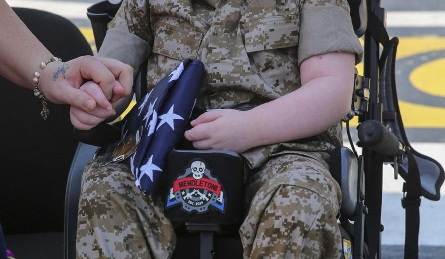 Wyatt Gillette, 8, visits Camp Pendleton, Calif., Saturday, July 30, 2016, where he received an award to become an honorary Marine. Gillette, who had the genetic disease Aicardi-Goutieres syndrome, which causes seizures and kidney failure, died Sunday, July 31, 2016. (Lance Cpl. Angelica Annastas/U.S. Marine Corps via AP)
