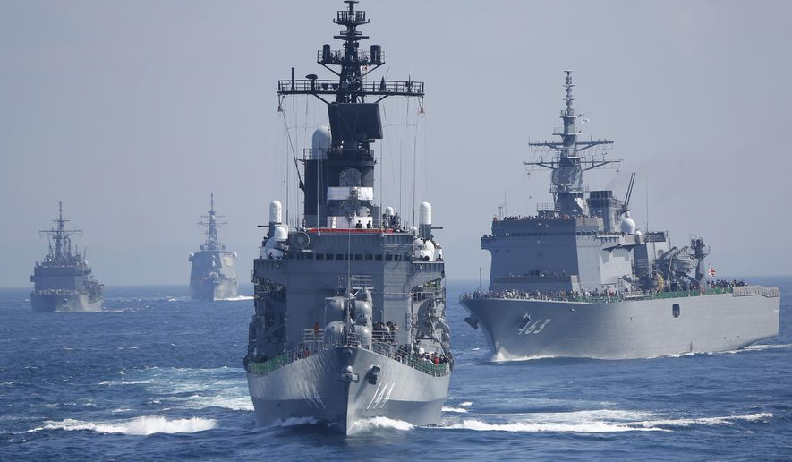 "FILE - In this Oct. 18, 2015 file photo, Japan Maritime Self-Defense Force (JMSDF) escort ship ""Kurama"" leads other vessels during a fleet review in the water off Sagami Bay, south of Tokyo.  Japan has called North Korea's nuclear and missile development a ""grave and imminent threat"" to the region and international security, and criticized China's increasingly assertive military action in its annual defense report.  The report, approved Tuesday, Aug. 2, 2016,  by the Cabinet, comes as Prime Minister Shinzo Abe's government pushes for Japan to take on greater military roles abroad.  (AP Photo/Shizuo Kambayashi, File)"