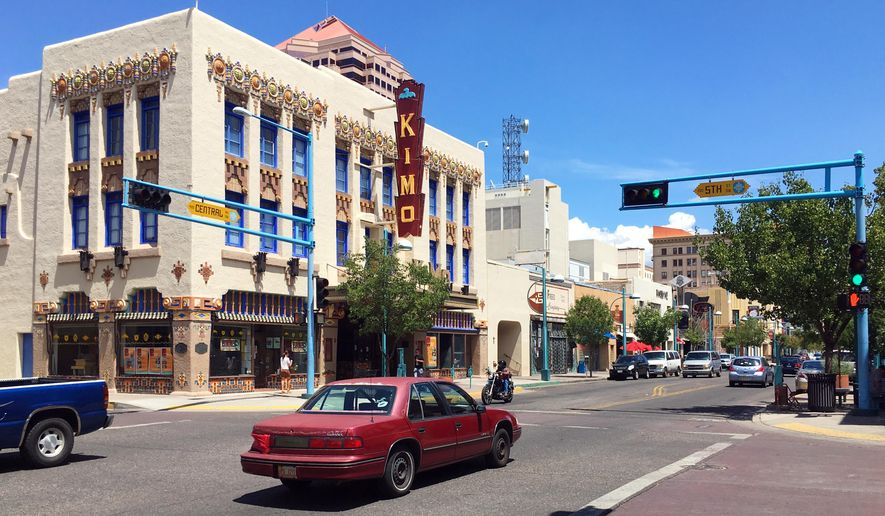 The Kimo Theater is seen on historic Route 66 in downtown Albuquerque, N.M., Monday, Aug. 1, 2016. Albuquerque was one of 16 New Mexico towns and cities to recently receive accreditation from the National Main Street Center setting up more possible funding for revitalizing downtowns. (AP Photo/Russell Contreras)