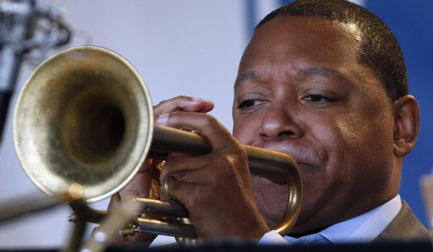 FILE - In this Saturday, Aug. 2, 2014 file photo, Wynton Marsalis performs with Jazz at Lincoln Center Orchestra during the Newport Jazz Festival in Newport, R.I. The Rockefeller Foundation and Jazz at Lincoln Center are teaming up to put jazz in the ears of thousands of urban school children across the globe. The tour, led by Wynton Marsalis, is designed for students with limited access to arts education in grades K-12. (AP Photo/Michael Dwyer, File)