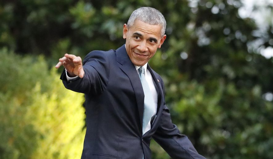 President Obama waves as he walks out to the South Lawn of the White House in Washington before boarding Marine One helicopter for the short flight to nearby Andrews Air Force Base on  July 27, 2016. (Associated Press) **FILE**