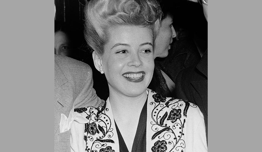 FILE - In this Feb. 24, 1944 file photo, actress Gloria DeHaven appears in Los Angeles. DeHaven, 91, the daughter of vaudeville stars who carved out her own successful career as the bright-eyed, vivacious star of Hollywood musicals and comedies of the 1940s and '50s, died Saturday, July 30, 2016, in Las Vegas. She was in hospice care after suffering a stroke a few months ago, her agent Scott Stander said Monday. (AP Photo, File)