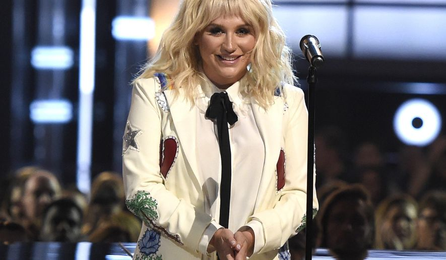FILE - In this May 22, 2016 file photo, Kesha appears on stage at the Billboard Music Awards in Las Vegas. Kesha on Monday, Aug. 1, 2016, dismissed a lawsuit she filed in Los Angeles alleging hitmaking producer Dr. Luke subjected her to sexual and emotional abuse, in a move her lawyer said was made to focus on similar litigation filed in New York. (Photo by Chris Pizzello/Invision/AP, File)