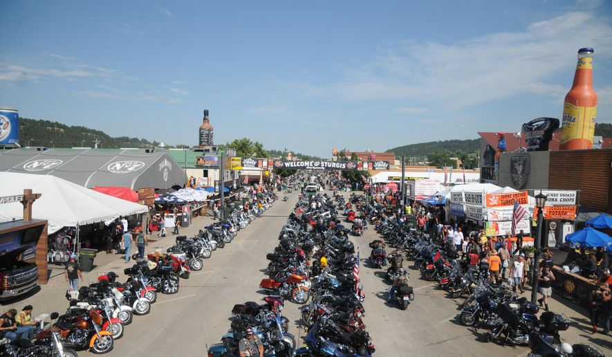 FILE - In this Aug. 5, 2015, file photo, motorcycles stretch down Main Street in Sturgis, S.D., for the landmark Sturgis Motorcycle Rally. Officials are expecting a smaller and quieter rally than last year's 75th anniversary event, which drew record crowds. The 76th rally in western South Dakota's Black Hills is Aug. 8-14, 2016. (AP Photo/James Nord, File)