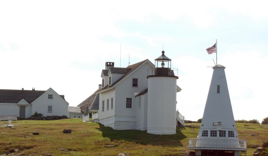This July 20, 2016 photo shows a lighthouse as seen on a lighthouse tour operated by Monhegan Boat Line out of Port Clyde, Maine. The tour included a demonstration of lobstering by a guide and third-generation lobsterman. (Debbie Galant via AP)
