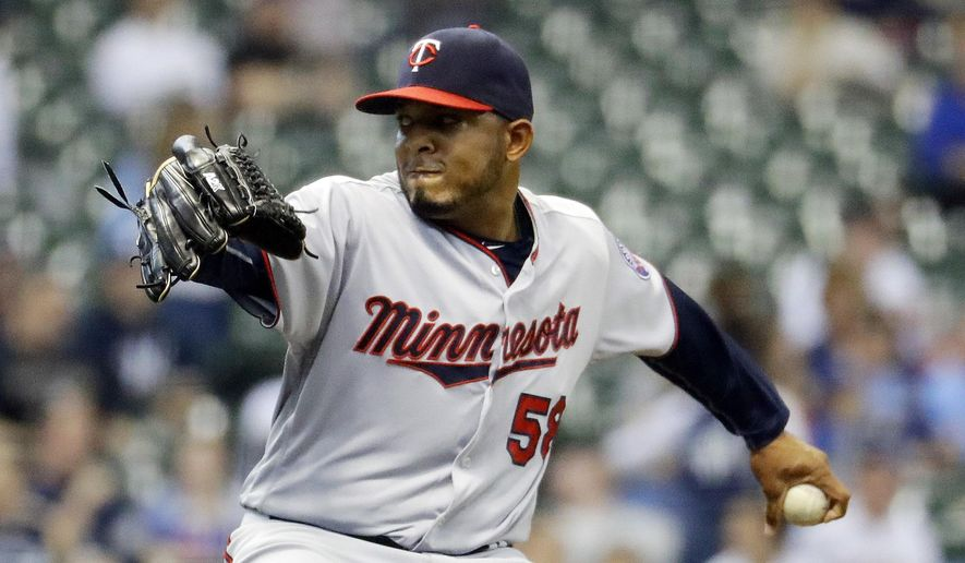 FILE - In this April 21, 2016, file photo, Minnesota Twins relief pitcher Fernando Abad throws during the seventh inning of a baseball game against the Milwaukee Brewers, in Milwaukee. The Boston Red Sox have acquired left-handed reliever Fernando Abad from the Minnesota Twins for minor league pitcher Pat Light. The deal was the first announced Monday, Aug. 1, 2016. (AP Photo/Morry Gash)