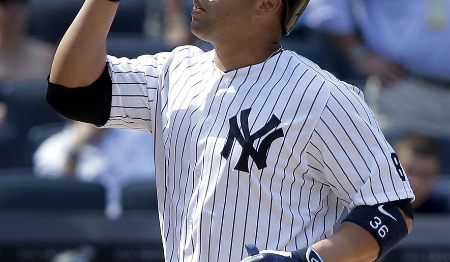 FILE - In this June 22, 2016, file photo, New York Yankees' Carlos Beltran reacts as he crosses the plate after hitting a three-run home run against the Colorado Rockies during the seventh inning of a baseball game, in New York. The Yankees stepped up their rebuilding, Monday, Aug. 1, 2016, trading outfielder Carlos Beltran to the AL West-leading Texas Rangers for right-hander Dillon Tate, the fourth overall pick in the 2015 amateur draft, and two other pitching prospects. (AP Photo/Julie Jacobson, File)