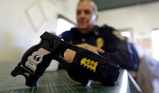 The legal challenge comes after stun gun bans were thrust into the spotlight in March, when the U.S. Supreme Court threw out a Massachusetts court ruling that had upheld a woman's criminal conviction of carrying a stun gun in violation of a state ban. (Associated Press)
