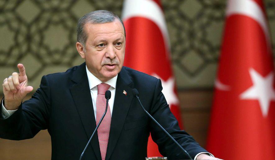 "Turkish President Recep Tayyip Erdogan, lashing out Tuesday at Amnesty International said his government has ""zero tolerance toward torture."" (Associated Press)"