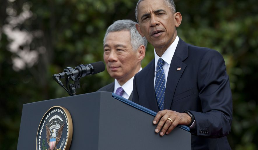 President Barack Obama, with Singapore's Prime Minister Lee Hsien Loong, speaks during a state arrival ceremony for the Singaporean prime minister on the South Lawn of the White House in Washington, Tuesday, Aug. 2, 2016. (AP Photo/Manuel Balce Ceneta)