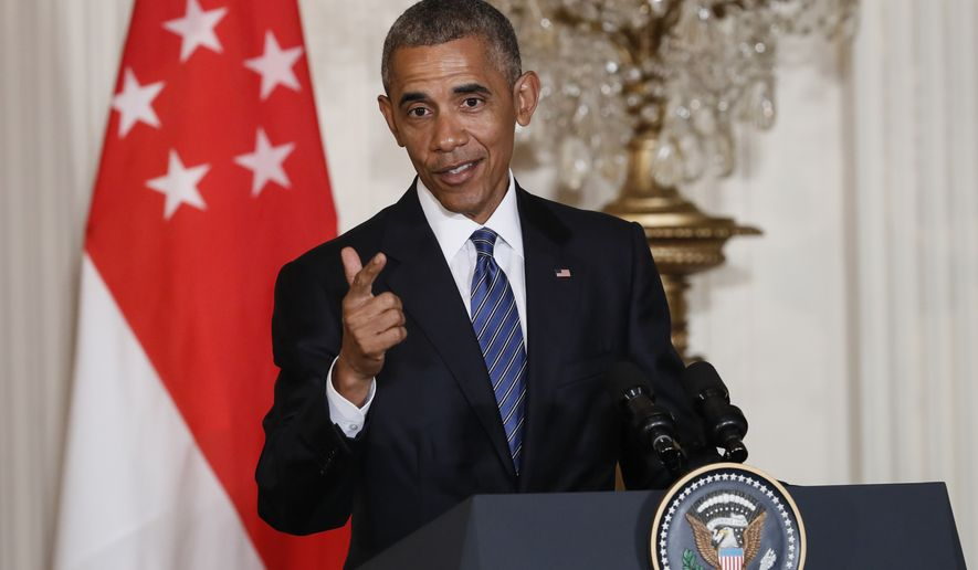 President Barack Obama answers a question a joint news conference with Singapore's Prime Minister Lee Hsien Loong at the White House in Washington, Tuesday, Aug. 2, 2016. The prime minister of the Southeast Asian city state joins Obama in Washington to celebrate the 50th anniversary of diplomatic relations and the contentious Trans-Pacific Partnership free trade deal is high on their agenda. (AP Photo/J. Scott Applewhite)