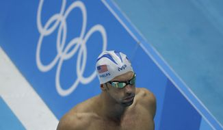 United States' Michael Phelps walks past the Olympic rings during a swimming training session prior to the 2016 Summer Olympics in Rio de Janeiro, Brazil, Tuesday, Aug. 2, 2016. (AP Photo/Matt Slocum)