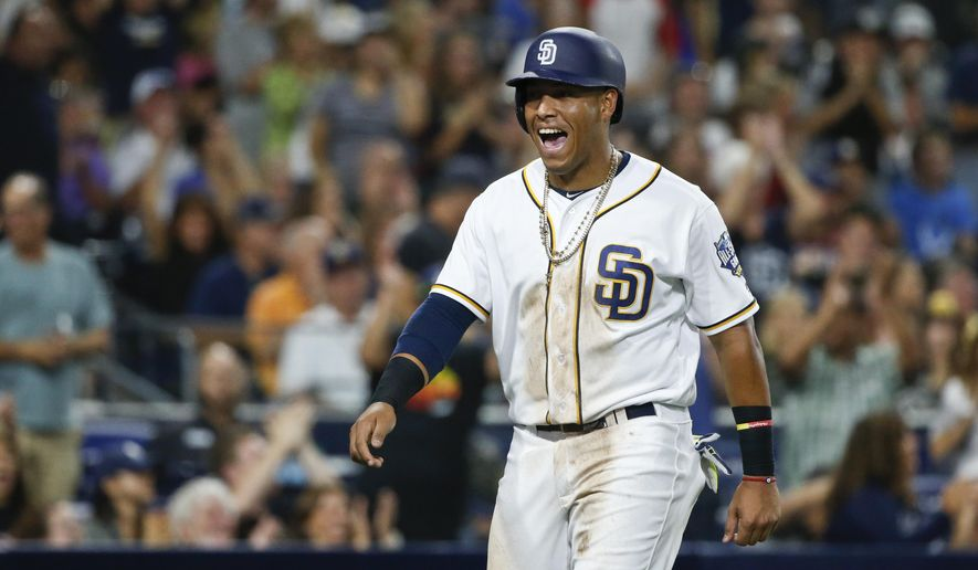 San Diego Padres' Yangervis Solarte is all smiles after scoring from first on a triple by Ryan Schimpf in the fifth inning of a baseball game Monday, Aug. 1, 2016, in San Diego. (AP Photo/Lenny Ignelzi)