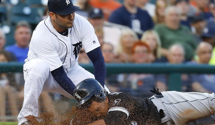 Detroit Tigers pitcher Anibal Sanchez (19) tags Chicago White Sox's Tyler Saladino (18) out on an attempted steal of third base during the fifth inning of a baseball game Tuesday, Aug. 2, 2016, in Detroit. (AP Photo/Paul Sancya)