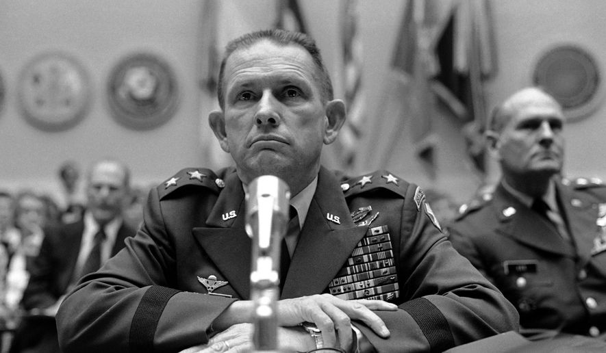 FILE - In this May 26, 1977 file photo, Major Gen. John K. Singlaub testifies on Capitol Hill in Washington before a House Armed Services subcommittee on the military situation in Korea. Singlaub, the fourth-ranking American officer in Korea, was removed from his post for saying President Jimmy Carter's U.S. troop withdrawal plans would lead to war. Republican presidential candidate Donald Trump has alarmed U.S. allies in Asia and elsewhere by suggesting that American military support should depend on their willingness to pay. But he would not be the first U.S. president to consider shaking up time-honored military deployments.Four decades ago, then-President Carter tried to withdraw American troops in South Korea, and failed. He wanted to trim fat from the U.S. defense budget and put pressure on South Korea over human rights abuses, but hit a wall of opposition in his own administration and in Seoul. (AP Photo, File)